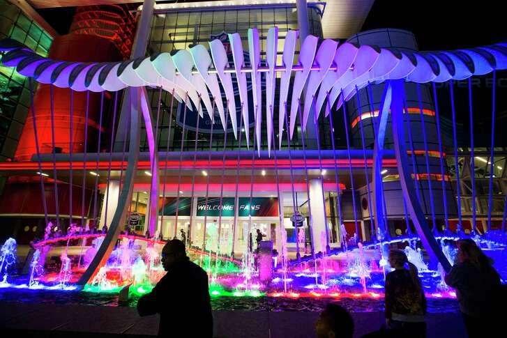 People enjoy the Wings over Water kinetic sculpture on the Avenida Houston, the new civic plaza in front of the George R. Brown Convention Center, Wednesday, Jan. 25, 2017 in Houston. ( Michael Ciaglo / Houston Chronicle )