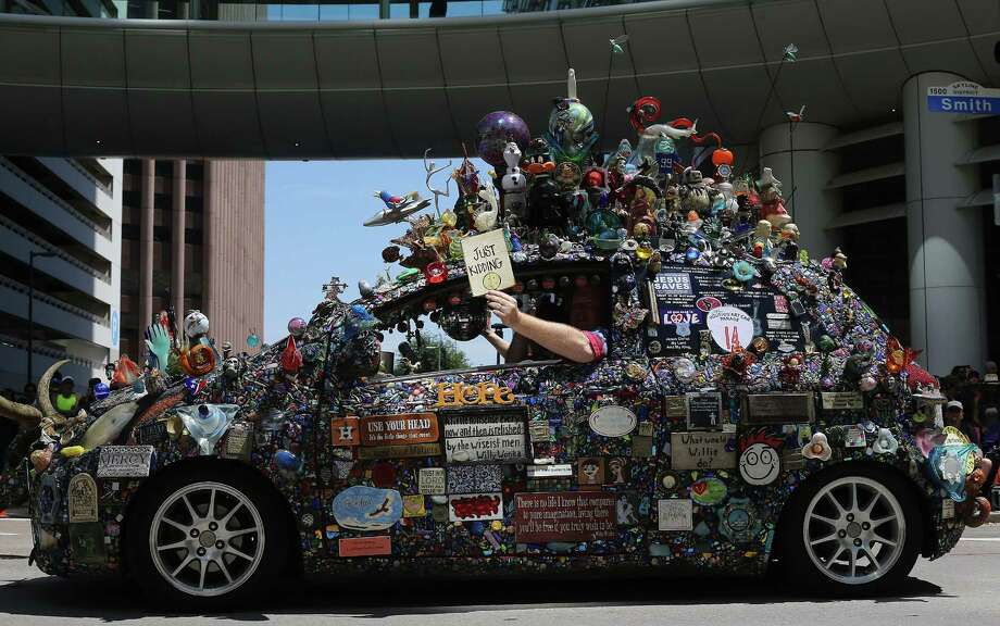 Get a glimpse at some of the cars taking part in the Houston Art Car Parade during a preview party on Saturday. Photo: Elizabeth Conley, Staff / © 2016 Houston Chronicle