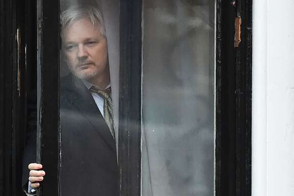 (FILES) This file photo taken on February 05, 2016 shows WikiLeaks founder Julian Assange coming out on the balcony of the Ecuadorian embassy to address the media in central London. A Swedish appeals court will decide on September 16, 2016 whether to maintain an arrest warrant for WikiLeaks founder Julian Assange over a 2010 rape accusation which he fears could lead to his extradition to the US. / AFP PHOTO / BEN STANSALLBEN STANSALL/AFP/Getty Images