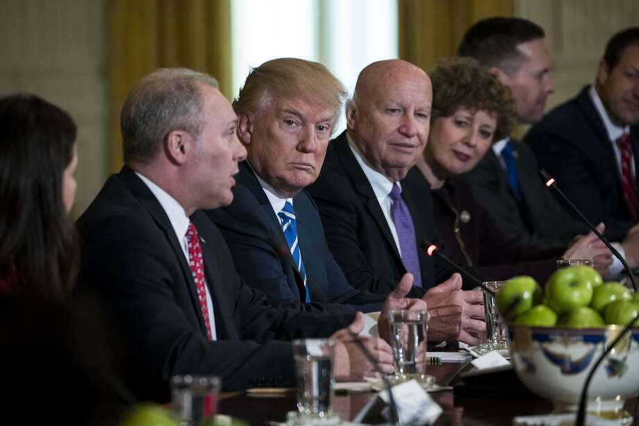 President Donald Trump listens as Rep. Steve Scalise (R-La.), left, the majority whip, spoke during a meeting about efforts to repeal and replace the Affordable Care Act, at the White House in Washington, March 7, 2017. A number of conservatives have already sharply criticized the bill which House Republicans unveiled on Monday. (Doug Mills/The New York Times) Photo: DOUG MILLS, NYT