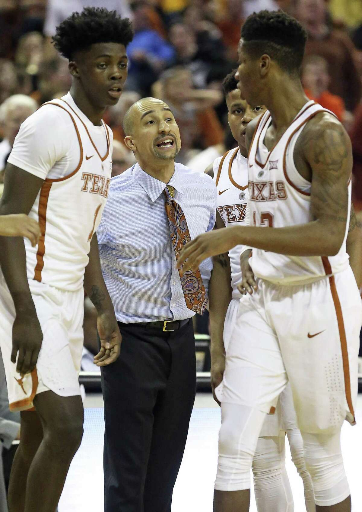 Longhorn coach Shaka Smart instructs players after a foul as UT takes on West Virginia at the Erwin Center on Jan., 14, 2017.