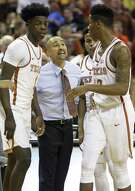 Longhorns coach Shaka Smart instructs players after a foul as UT takes on West Virginia at the Erwin Center in Austin on Jan., 14, 2017.