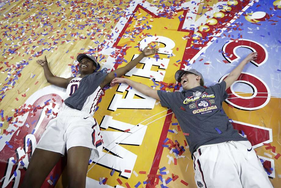 Gonzaga's Zykera Rice, left, and Elle Tinkle make confetti angels on the floor after their team's WCC championship win. Photo: John Locher, Associated Press