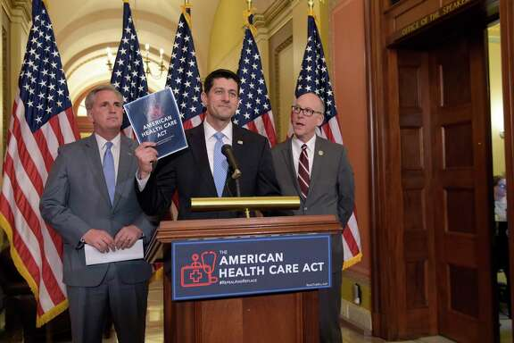 House Speaker Paul Ryan of Wisconsin, center, speaks during a news conference on the American Health Care Act on Tuesday.