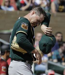 Oakland Athletics' Sonny Gray wipes his face after giving up a three-run home run to Arizona Diamondbacks' Ketel Marte during the first inning of a spring training baseball game Tuesday, March 7, 2017, in Scottsdale, Ariz. (AP Photo/Darron Cummings)