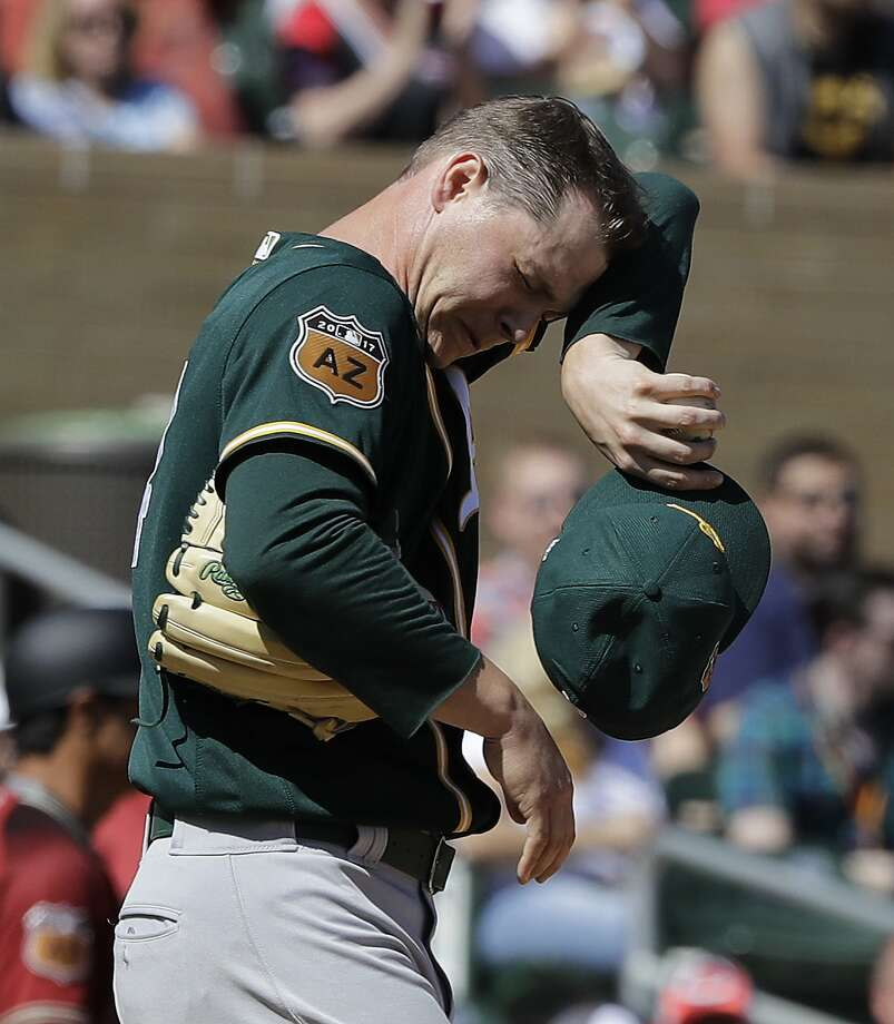 Oakland Athletics' Sonny Gray wipes his face after giving up a three-run home run to Arizona Diamondbacks' Ketel Marte during the first inning of a spring training baseball game Tuesday, March 7, 2017, in Scottsdale, Ariz. (AP Photo/Darron Cummings) Photo: Darron Cummings, Associated Press