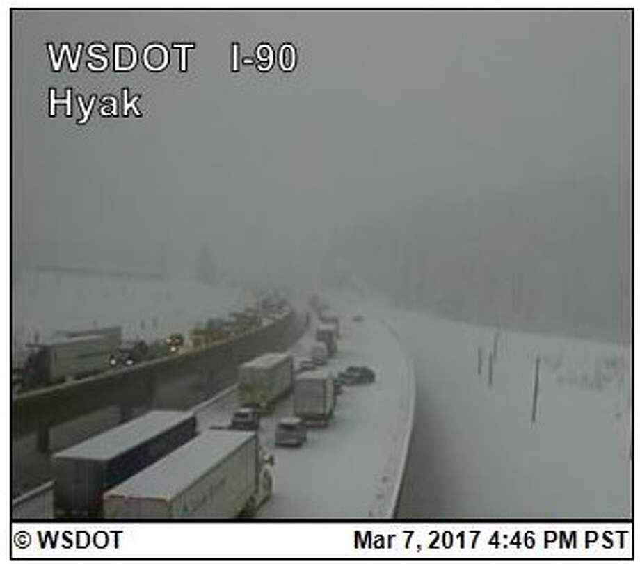 Snoqualmie Pass closed again Tuesday afternoon after continued heavy snowfall led to slippery conditions and multiple vehicles crashed. Photo: WSDOT