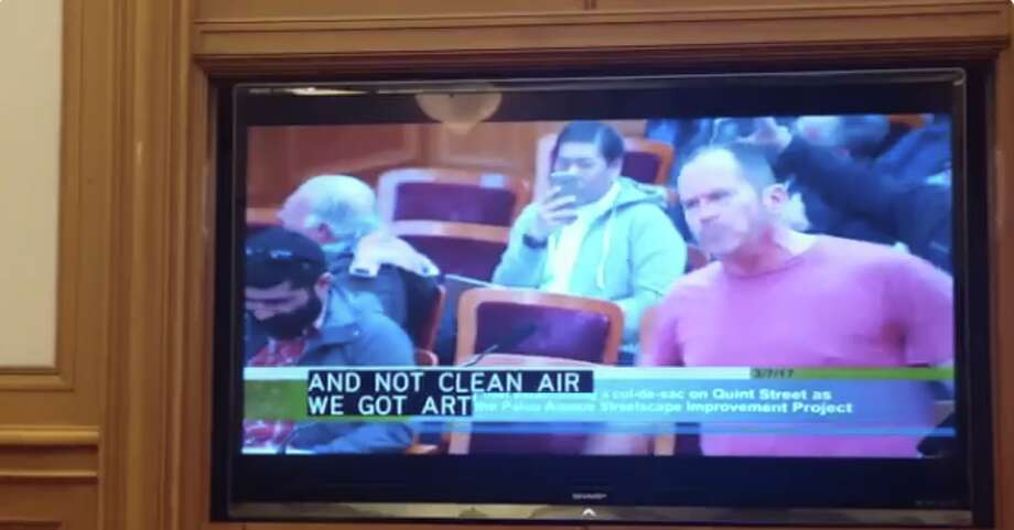 San Francisco resident Christopher Logan raps about angled parking at a public meeting at San Francisco City Hall on Tuesday, March 7, 2017.