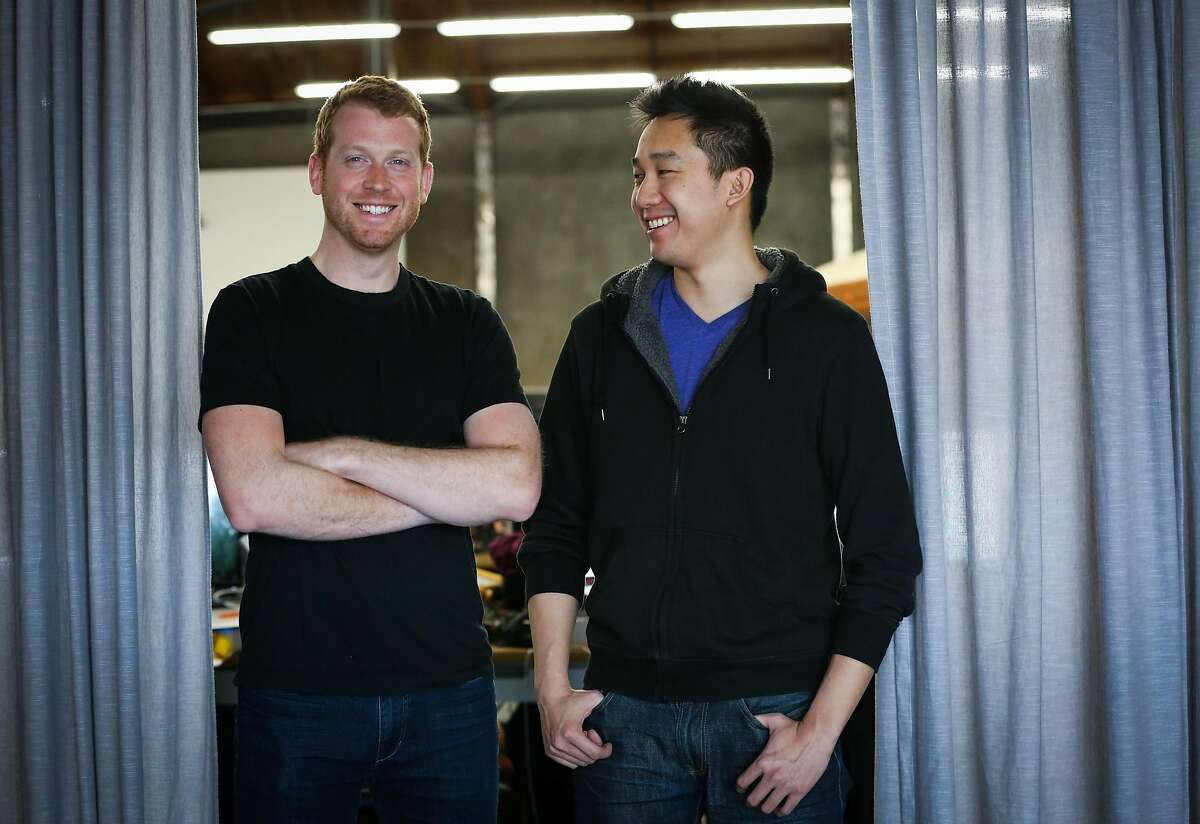 Co-founders Kyle Vogt and Daniel Kan (right) stand for a portrait at company Cruise Automation in San Francisco, California, on Tuesday, March 7, 2017.