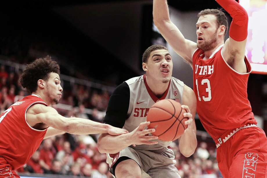 Stanford's Reid Travis, center, looks to shoot between Utah's Devon Daniels, left, and David Collette, right, during the first half of an NCAA college basketball game Saturday, Feb. 4, 2017, in Stanford, Calif. (AP Photo/Ben Margot) Photo: Ben Margot / Associated Press / Copyright 2017 The Associated Press. All rights reserved.