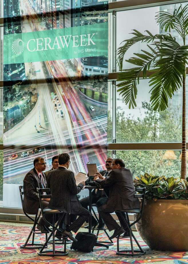 Attendees sit around a table at the 2017 IHS CERAWeek conference in Houston, Texas, U.S., on Monday, March 6, 2017. CERAWeek gathers energy industry leaders, experts, government officials and policymakers, leaders from the technology, financial, and industrial communities to provide new insights and critically-important dialogue on energy markets. Photographer: F. Carter Smith/Bloomberg / © 2017 Bloomberg Finance LP