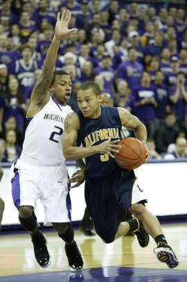 Washington's Isaiah Thomas, left, defends California's Jerome Randle during the first half of a NCAA college basketball game in Seattle, on Saturday, Jan. 16, 2010. Washington defeated California 84-69. (AP Photo/Kevin P. Casey)