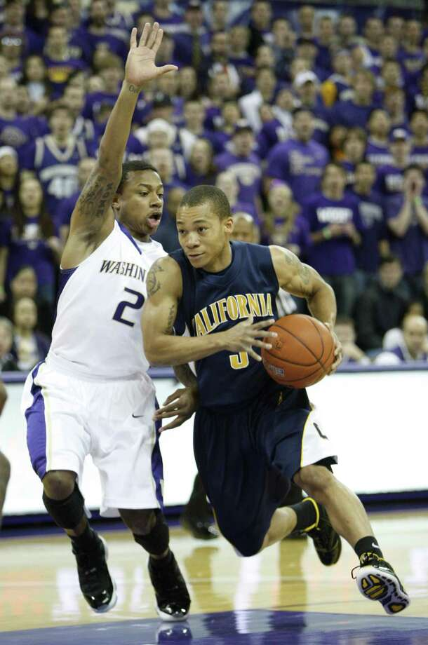 Washington's Isaiah Thomas, left, defends California's Jerome Randle during the first half of a NCAA college basketball game in Seattle, on Saturday, Jan. 16, 2010. Washington defeated California 84-69. (AP Photo/Kevin P. Casey) Photo: Kevin P. Casey / AP / AP2010