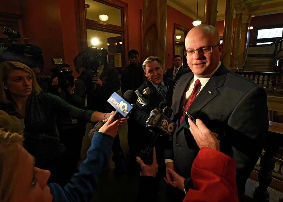 Rensselaer County District Attorney Joel Abelove, right gives his thoughts on the case after Jacob Heimroth was sentenced to 50 years to life for the murder of Allen and Maria Lockrow by Supreme Court Judge Andrew Ceresia at the Rensselaer County Courthouse Wednesday January 4, 2017 in Rensselaer,  N.Y. (Skip Dickstein/Times Union) Photo: SKIP DICKSTEIN / 20039289A