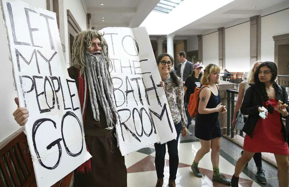 John Erler, from Austin, draws attention to his Moses like signage in the hallways as the Senate State Affairs committee holds a hearing on the controversial bathroom bill,bill SB6, in the Capitol on March 7, 2017. Photo: Tom Reel, Staff / San Antonio Express-News / 2017 SAN ANTONIO EXPRESS-NEWS