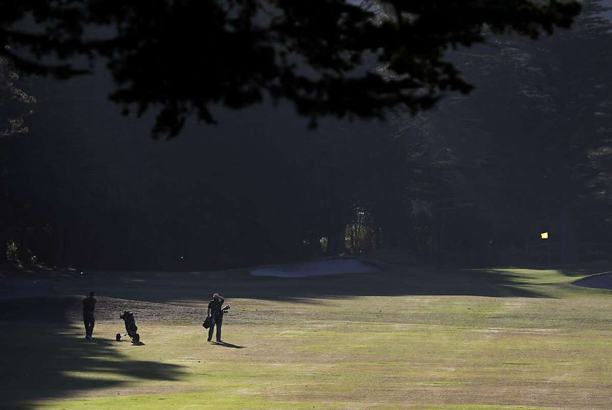 Golfers hit their approach shots towards the 3rd green at Sharp Park Golf Course in Pacifica, Calif. on Thursday, Jan. 16, 2014. Proposed improvements to a pump house and a cart path at the San Francisco city owned course worry environmentalists.