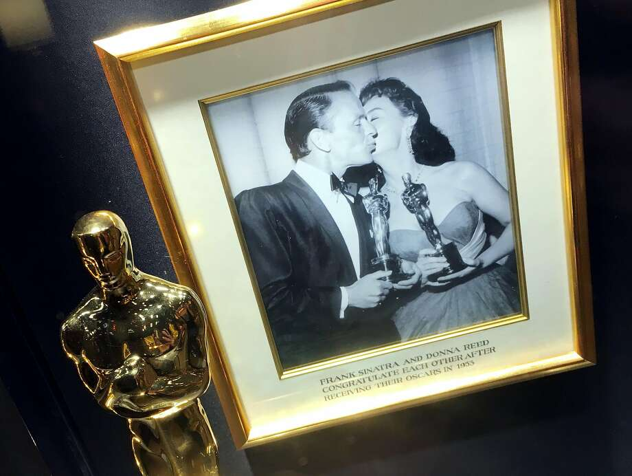 "The Oscar that Frank Sinatra won for ""From Here to Eternity,"" along with a photo of Sinatra with actress Donna Reed, in a display case at Sinatra's restaurant and bar at Encore. Photo: Spud Hilton, The Chronicle"