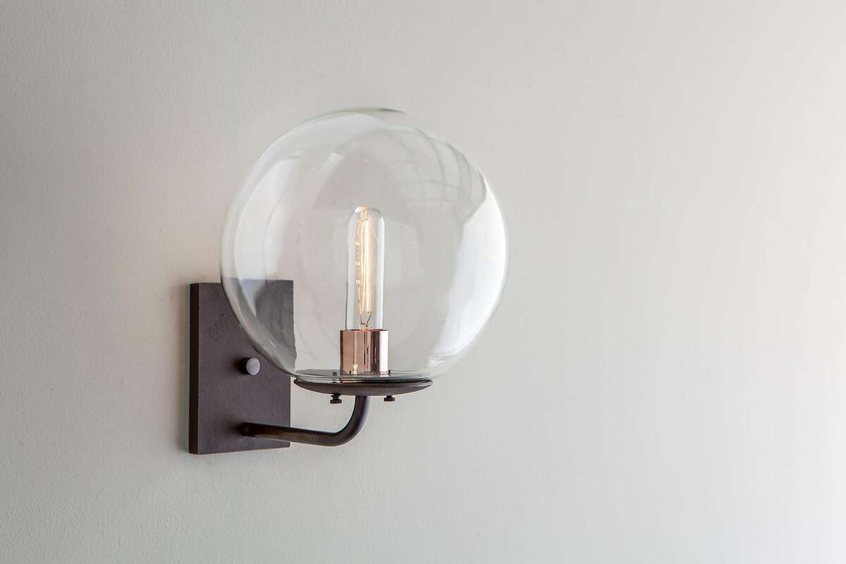 The Cooper scone has a 10? hand blown globe mounted on a cast brass cradle with copper accents.