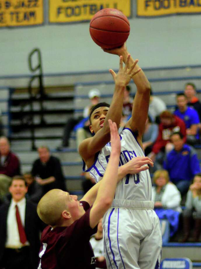 Bunnell's Khalid Moreland lays up to the basket over East Lyme's J.R. Gandenberger during CIAC Boys Basketball tournament action in Stratford, Conn., on Tuesday Mar. 7, 2017. Photo: Christian Abraham / Hearst Connecticut Media / Connecticut Post