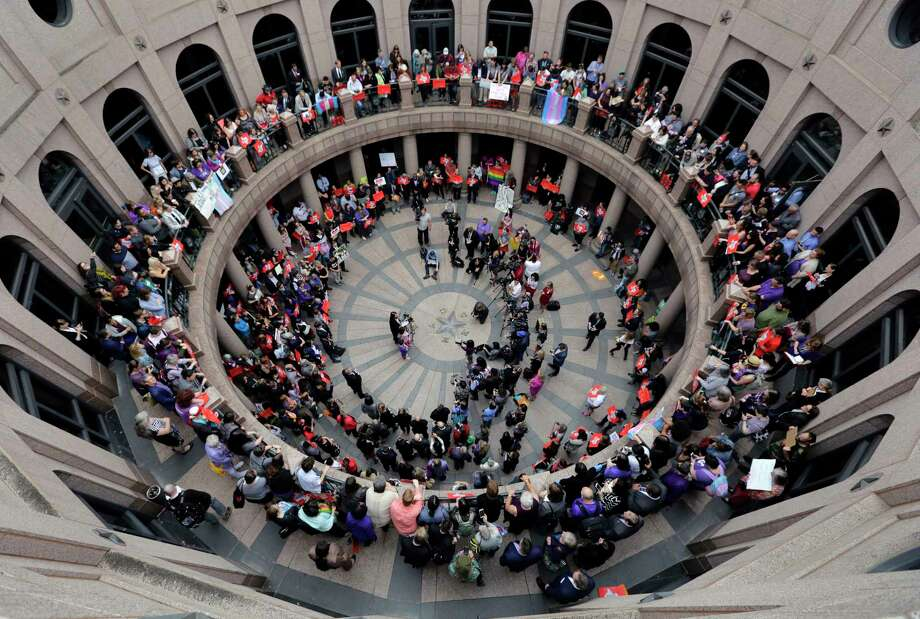 """Members of the transgender community and others who oppose Senate Bill 6, known as the """"bathroom bill,"""" protest in the exterior rotunda at the state Capitol during the Senate State Affairs Committee hearing. Photo: Eric Gay, STF / Copyright 2017 The Associated Press. All rights reserved."""