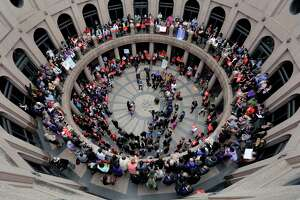"""Members of the transgender community and others who oppose Senate Bill 6, known as the """"bathroom bill,"""" protest in the exterior rotunda at the state Capitol during the Senate State Affairs Committee hearing."""