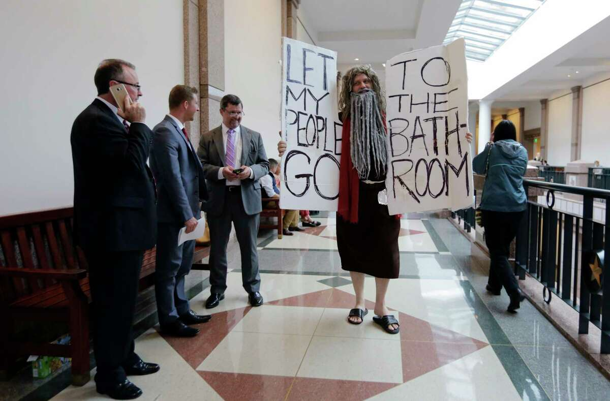 """John Erler protests the """"bathroom bill"""" as a state panel heard testimony - from transgender people, rape victims, business leaders and scores of others - on the likely effects of the bill."""