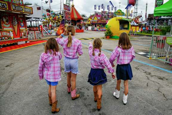 Looking for the next carnival game to play at the Houston Livestock Show and Rodeo are, from left,  Archer Williams, 5, Julia Hunter Williams, 9, Claire Kapinos, 8, and Holt Williams, 7. Story on page A2.