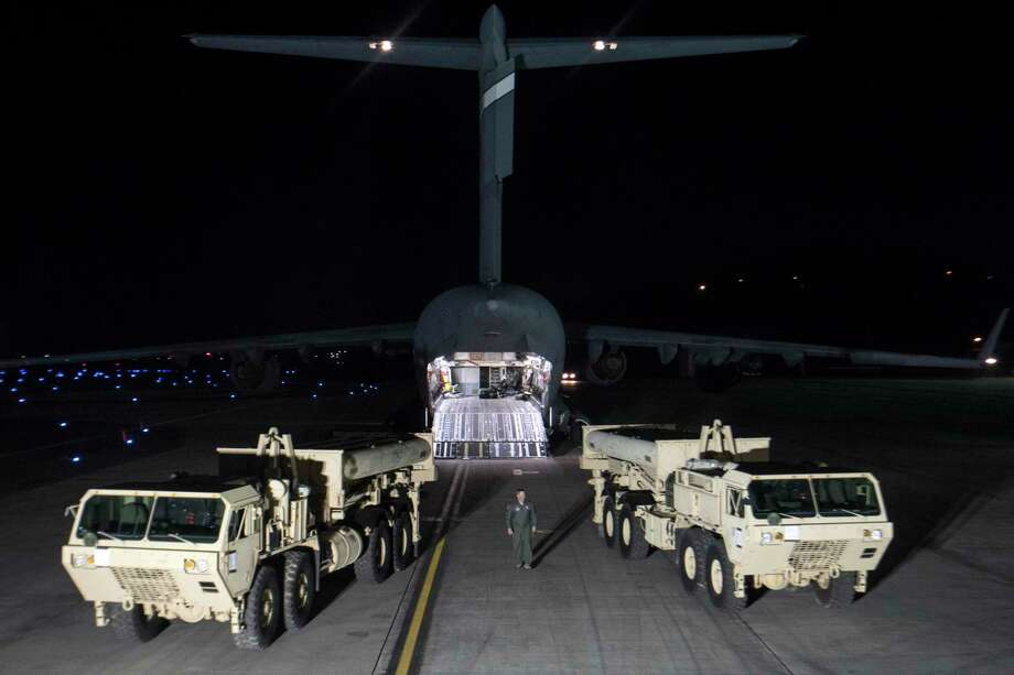 Trucks carrying parts of U.S. missile launchers and other equipment arrive at Osan air base in Pyeongtaek, South Korea. Monday, March 6, 2017. The US military has begun moving equipment for the controversial missile defense system to ally South Korea. The announcement Tuesday by the U.S. military comes a day after North Korea test-launched four ballistic missiles into the ocean near Japan. (U.S. Force Korea via AP) Photo: HOGP / US Forces Korea