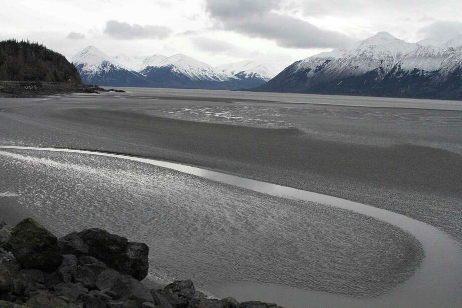 A ribbon of water cuts through the mud flats of Cook Inlet, just offshore of Anchorage, Alaska. Natural gas is leaking into the inlet from a pipeline. Photo: Mark Thiessen, STF