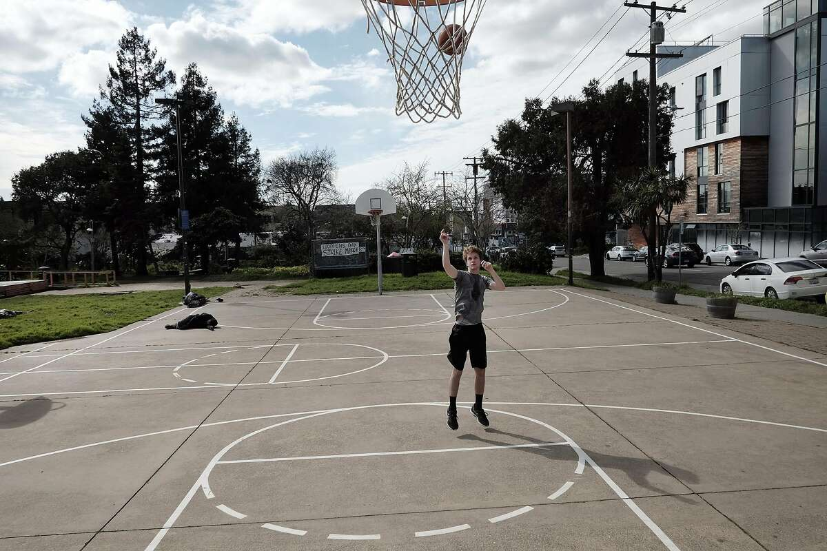 UC Berkeley freshman student Connor Dolan shoots hoops on the basketball court at People's Park in Berkeley, CA, on Tuesday March 7, 2017.
