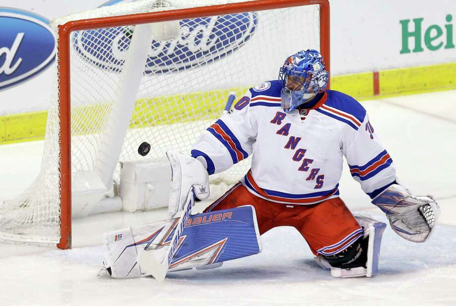 New York Rangers goalie Henrik Lundqvist (30) deflects a shot by the Florida Panthers in the first period of an NHL hockey game, Tuesday, March 7, 2017, in Sunrise, Fla. (AP Photo/Alan Diaz) ORG XMIT: FLAD105 Photo: Alan Diaz / Copyright 2017 The Associated Press. All rights reserved.