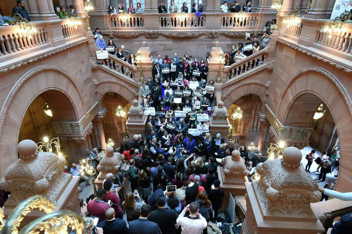 Demonstrators sit on the Million Dollar staircase at the State Capitol during a rally on raising the age of criminal responsibility Tuesday Mar. 7, 2017 in Albany, N.Y. The 2020 pandemic has stopped special interest groups from being able to occupy the Capitol and push their agendas. (Skip Dickstein/Times Union)