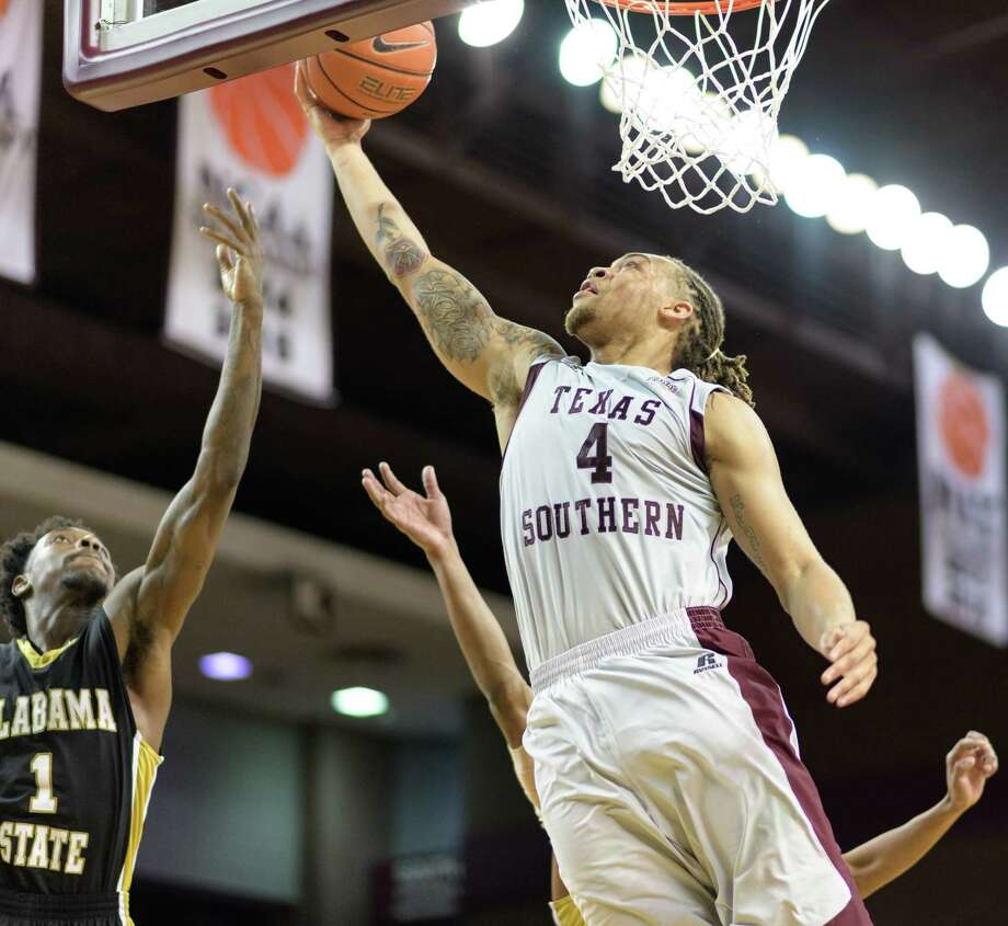 Kevin Scott (4) of the TSU Tigers goes for a layup against the Alabama State Hornets in a college basketball game on Tuesday, March 7, 2017 at H&PE Arena on the TSU Campus. Photo: Wilf Thorne, For The Chronicle / © 2017 Houston Chronicle