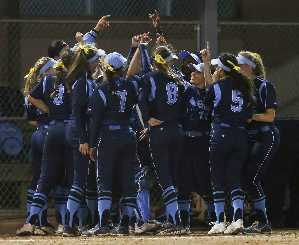 The Johnson softball team gathers before their game against MacArthur in girls softball at NEISD Complex's West Field on Tuesday, Mar. 7, 2017. Johnson is No. 1 and MacArthur is No. 2 in Express-News Area rankings. (Kin Man Hui/San Antonio Express-News)