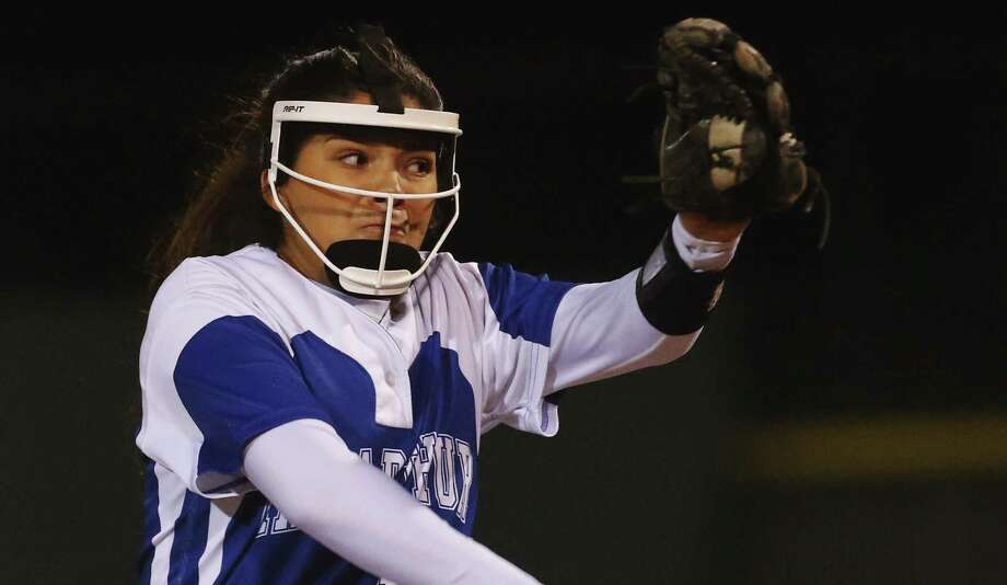 MacArthur pitcher Kaitlyn Medina winds up for a delivery against Johnson at NEISD Complex's West Field on March 7, 2017. Photo: Kin Man Hui /San Antonio Express-News / ©2017 San Antonio Express-News