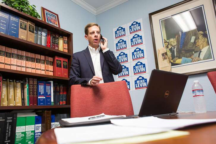 Democratic United States Congressional candidate Mike Levin talks with a reporter during a day of fundraising at the Law Office of Frank P. Barbaro on Tuesday, March 7, 2017 in Santa Ana, Calif. Levin drummed up support before announcing his candidacy for California's 49th congressional district Wednesday.