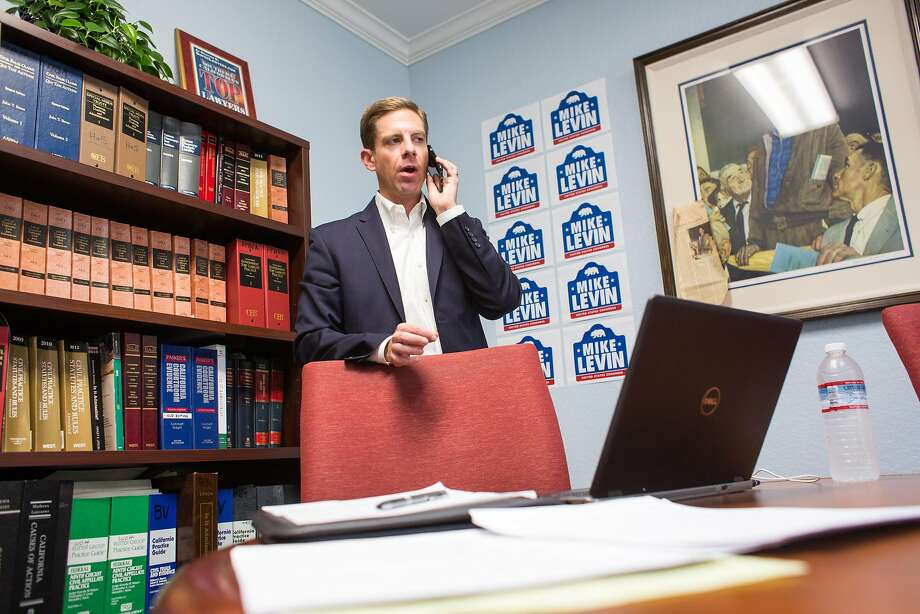 Democratic United States Congressional candidate Mike Levin talks with a reporter during a day of fundraising at the Law Office of Frank P. Barbaro on Tuesday, March 7, 2017 in Santa Ana, Calif. Levin drummed up support before announcing his candidacy for California's 49th congressional district Wednesday. Photo: Josh Barber, Special To The Chronicle
