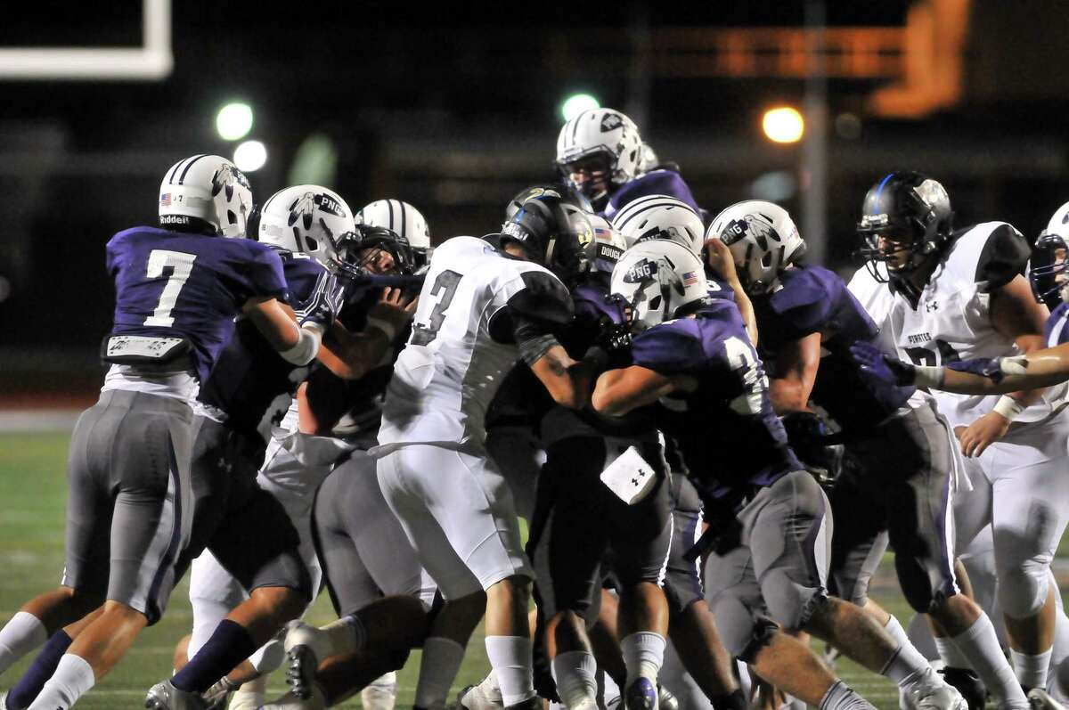 The Port Neches-Groves Indians and the Vidor Pirates scrum as the Pirates move toward their endzone near the end of the first quarter on Friday in Port Neches. (Mike Tobias/The Enterprise)