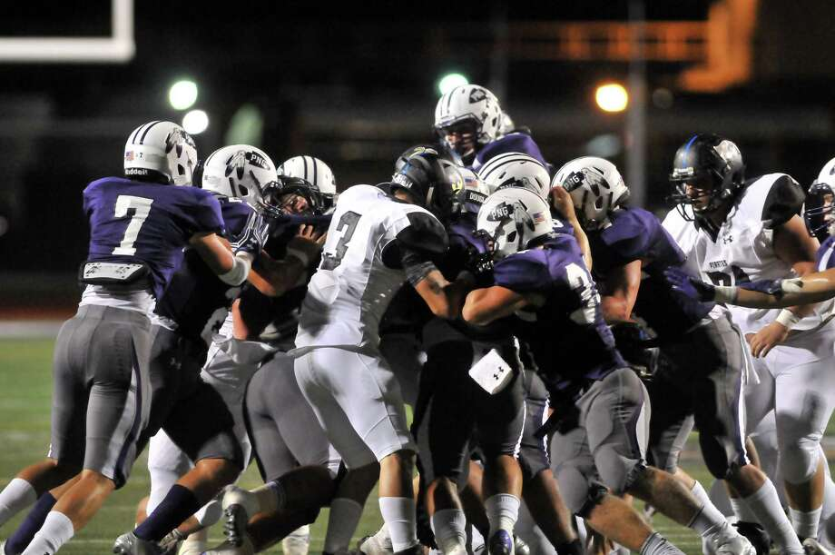 The Port Neches-Groves Indians and the Vidor Pirates scrum as the Pirates move toward their endzone near the end of the first quarter on Friday in Port Neches. (Mike Tobias/The Enterprise) Photo: Mike Tobias/The Enterprise
