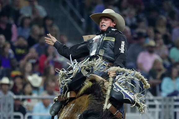 Alex Wright rides in the saddle bronc riding competition during the opening night of Rodeo and the Super Series I, Round 1 at the Houston Livestock Show and Rodeo, at NRG Park, March 7, 2017, in Houston.