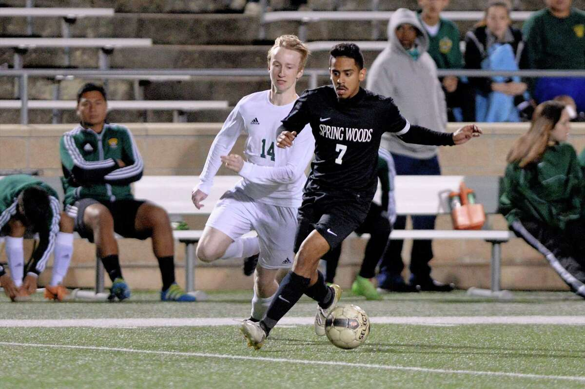 Sean Cooper (14) of Stratford chases Christian Hinojosa (7) of Spring Woods during the second half of a boys high school soccer game between the Stratford Spartans and the Spring Woods Tigers on Tuesday, March 7, 2017 at Tulley Stadium, Houston, TX.