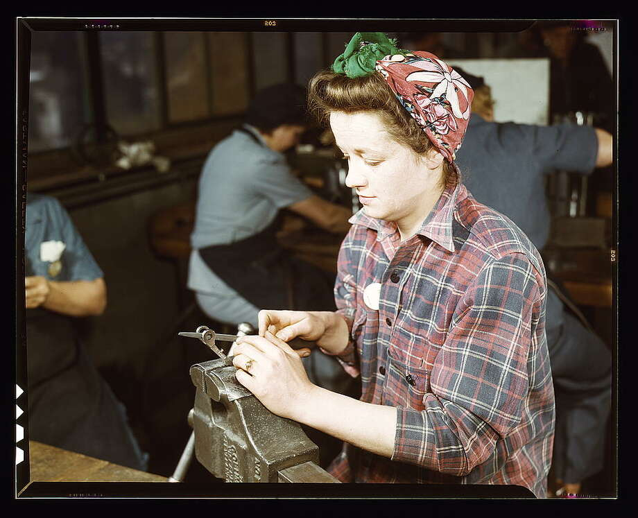 One of the girls of Vilter [Manufacturing] Co. filing small gun parts, Milwaukee, Wisc. One brother in Coast Guard, one going to Army. 1943 Feb. Hollem, Howard R., photographer. Photo: Library Of Congress