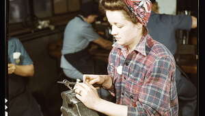 One of the girls of Vilter [Manufacturing] Co. filing small gun parts, Milwaukee, Wisc. One brother in Coast Guard, one going to Army. 1943 Feb. Hollem, Howard R., photographer.