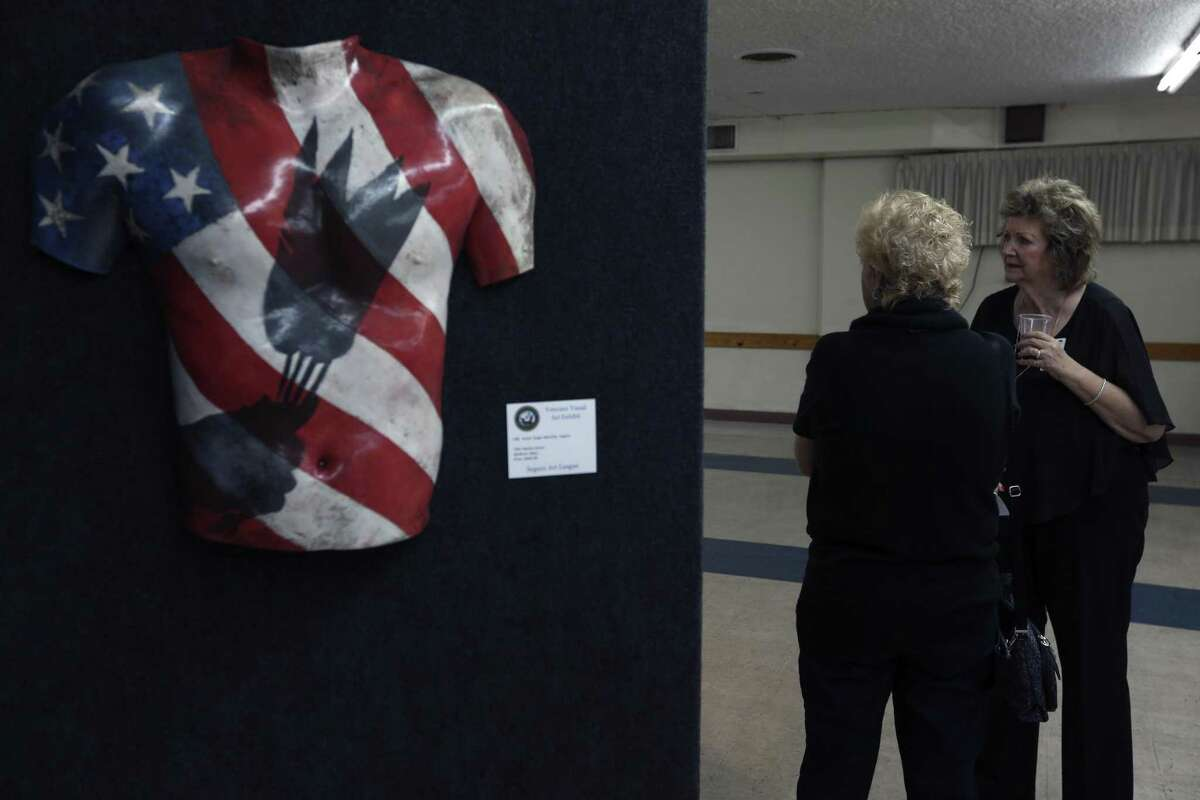 """One of the more than 75 artworks by about 35 military veteran artists is display Tuesday, March 7, 2017 at the H. U. Wood Post 245 American Legion Hall in Sequin on the first day of an exhibit sponsored by the Sequin Art League. The piece, titled """"Native Honor"""", is by artist Roger Betchler."""