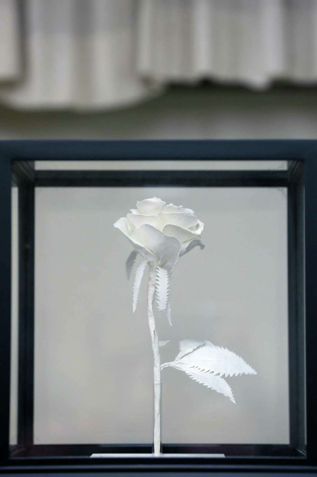 A paper rose, one of the more than 75 artworks by about 35 military veteran artists, is displayed Tuesday, March 7, 2017 at the H. U. Wood Post 245 American Legion Hall in Sequin on the first day of an exhibit sponsored by the Sequin Art League.