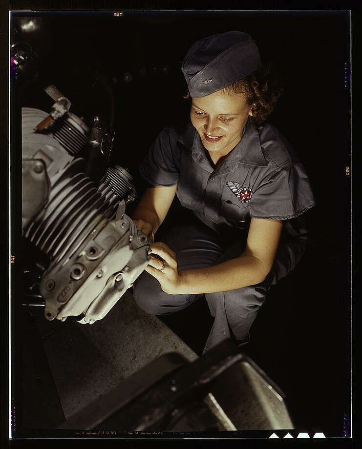 Assembly and Repairs Dept. mechanic Mary Josephine Farley works on a Wright Whirlwind motor, Naval Air Base, Corpus Christi, Texas. 1942 August. Hollem, Howard R., photographer. Photo: Library Of Congress