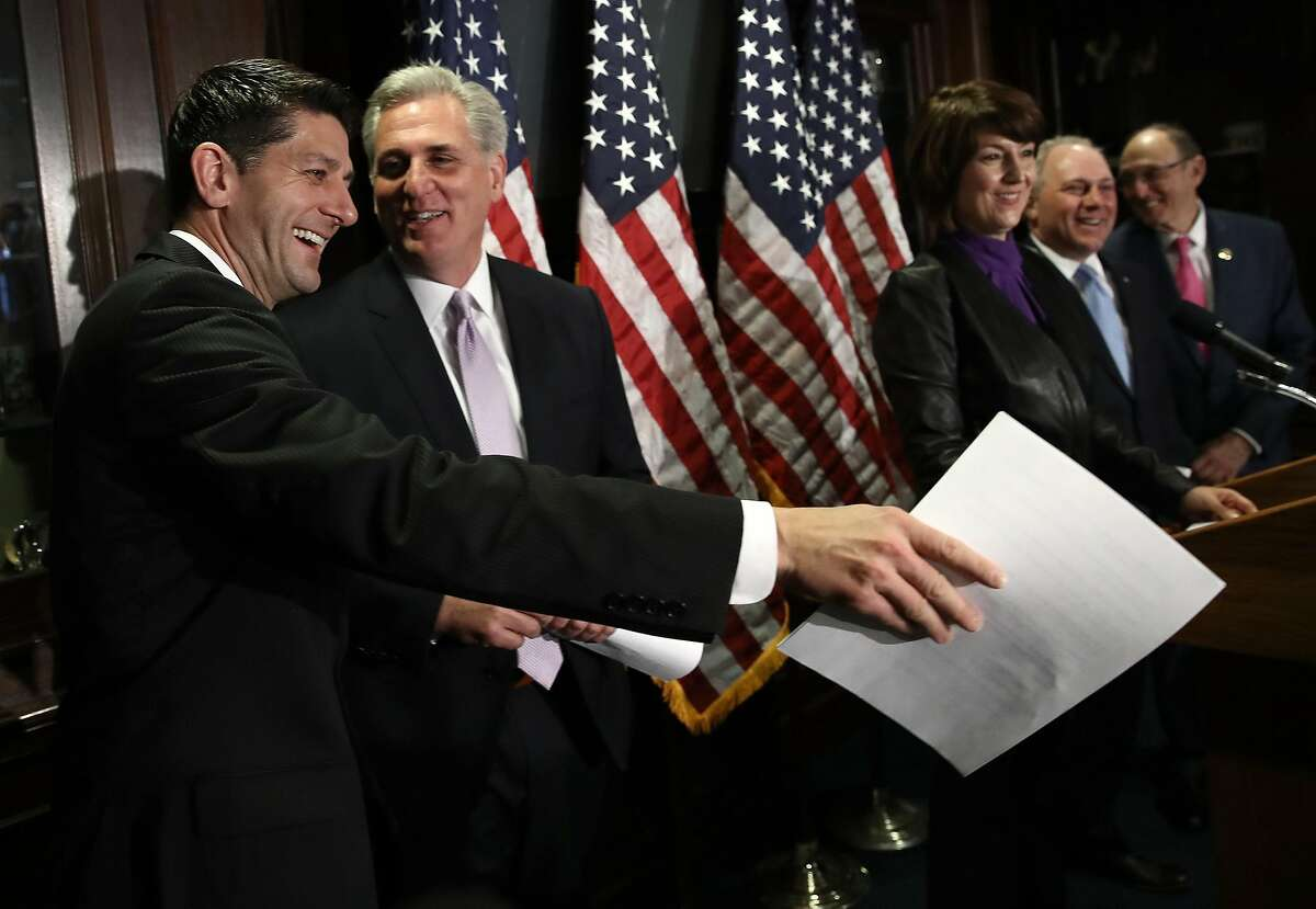 WASHINGTON, DC - MARCH 08: U.S. Speaker of the House Paul Ryan (R-WI) (L) jokes with House Majority Leader Kevin McCarthy during a press conference following a meeting of the House Republican caucus March 8, 2017 in Washington, DC. Ryan answered questions on the newly released American Healthcare Act, the proposed Republican replacement for the Affordable Care Act. (Photo by Win McNamee/Getty Images)
