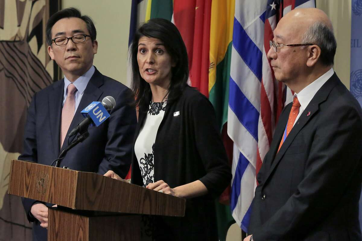 South Korea's Ambassador Cho Tae-yul, left, U.S. Ambassador Nikki Haley, center, and Japan's Ambassador Koro Bessho hold a joint news conference after consultations of the United Nations Security Council, Wednesday, March 8, 2017. (AP Photo/Richard Drew)
