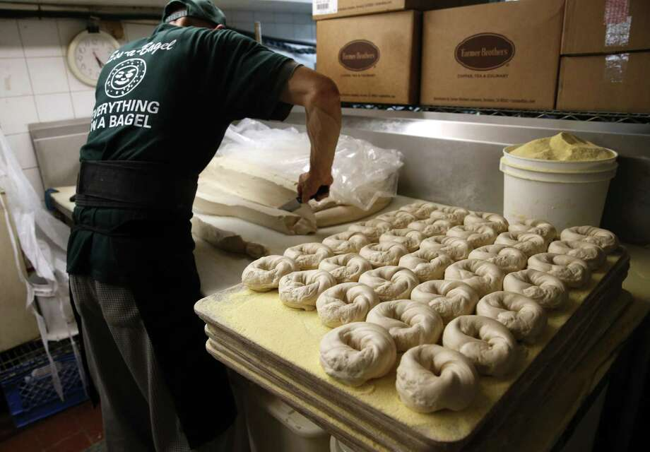 Employers added 235,000 workers to their payrolls in February, while average hourly earnings grew by 0.2 percent in a report that overlaps with President Trump's first full month in office. Photo: Kathy Willens /Associated Press / Copyright 2016 The Associated Press. All rights reserved. This material may not be published, broadcast, rewritten or redistribu