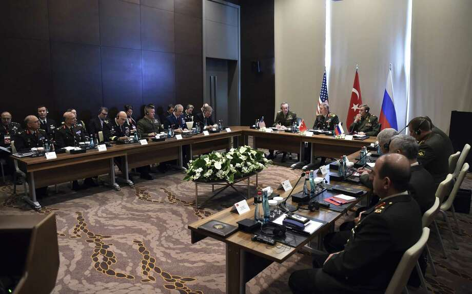 Turkey's Chief of Staff Gen. Hulusi Akar, center, U.S. Chairman of the Joint Chiefs of Staff Gen. Joseph Dunford, left, and Russia's Chief of Staff Gen. Valery Gerasimov and their delegations attend a meeting in the Mediterranean coastal city of Antalya, Turkey, Tuesday. Photo: Pool Photo /AP / Pool Turkish Military